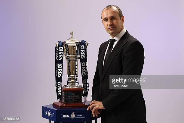 Head Coach Philippe SaintAndre of France poses with the RBS Six Nations trophy during the RBS Six Nations Launch at The Hurlingham Club on January 25...