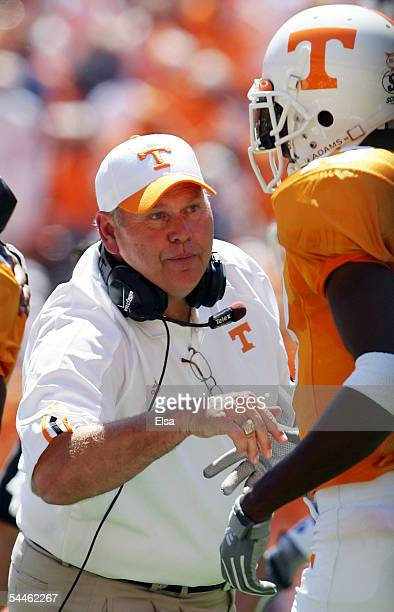Head coach Phillip Fulmer congratulates Chris Hannon of the Tennessee Volunteers after his touchdown in the first quarter against the UAB Blazers on...