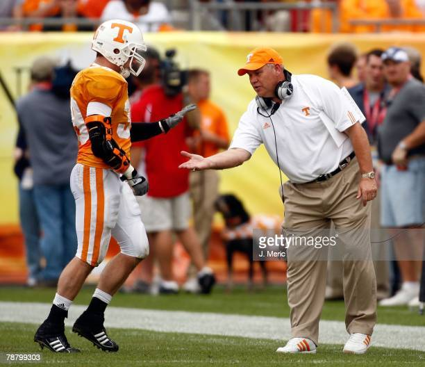 Head coach Phillip Fulmer of the Tennessee Volunteers congratulates linebacker Ryan Karl against the Wisconsin Badgers during the game on January 1,...