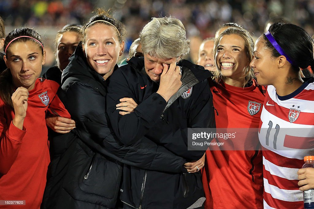 Head coach Pia Sundhage (C) for the USA is surrounded by her players during a post game tribute after she coached her final game for the USA as they defeated Australia 6-2 at Dick's Sporting Goods Park on September 19, 2012 in Commerce City, Colorado.