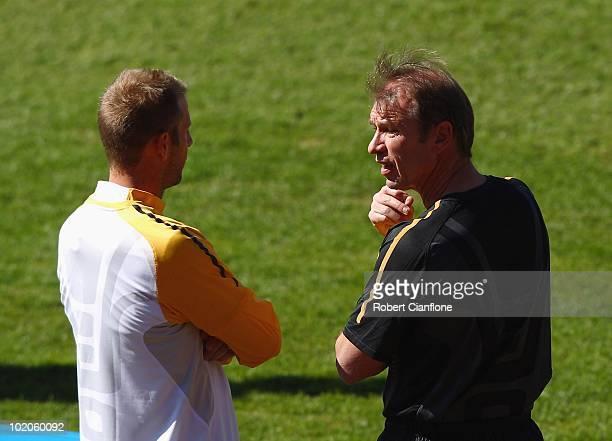 Head coach Pim Verbeek of Australia talks to Vince Grella during an Australian Socceroos trainin sessiong at Ruimsig Stadium on June 14 2010 in...