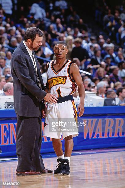 Head Coach PJ Carlesimo chats with Muggsy Bogues of the Golden State Warriors against the Detroit Pistons on November 12 1997 at Oracle Arena in...