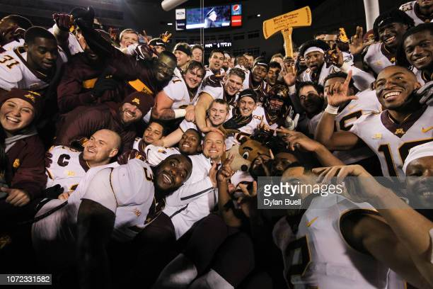 Head coach PJ Fleck of the Minnesota Golden Gophers celebrates with his team after beating the Wisconsin Badgers 3715 at Camp Randall Stadium on...
