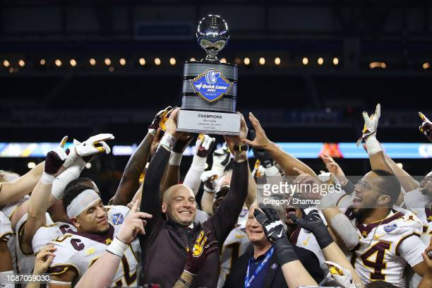 Head coach P.J. Fleck of the Minnesota Golden Gophers raises the trophy after winning the Quick Lane Bowl 34-10 over the Georgia Tech Yellow Jackets...