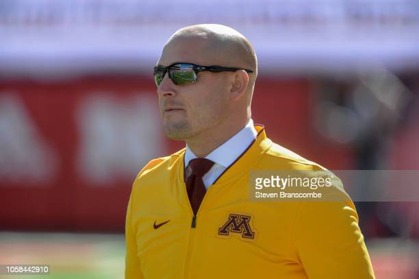 Head coach PJ Fleck of the Minnesota Golden Gophers watches pregame preparations before the contest against the Nebraska Cornhuskers at Memorial...