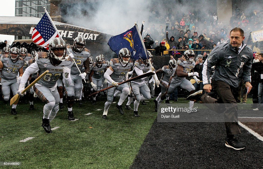 Head coach P.J. Fleck of the Western Michigan Broncos leads his team onto the field before the game against the Buffalo Bulls at Waldo Stadium on November 19, 2016 in Kalamazoo, Michigan.
