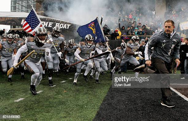 Head coach P.J. Fleck of the Western Michigan Broncos leads his team onto the field before the game against the Buffalo Bulls at Waldo Stadium on...