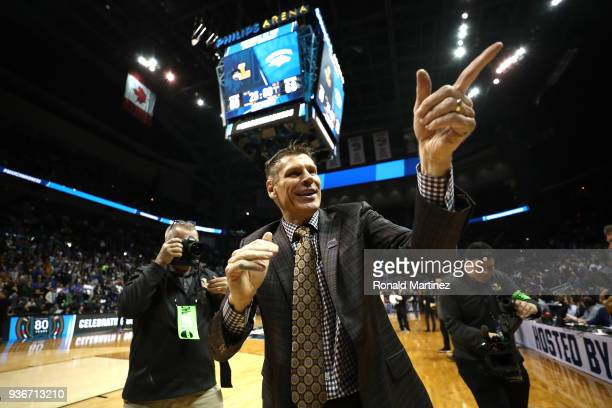 Head coach Porter Moser of the Loyola Ramblers celebrates after defeating the Nevada Wolf Pack during the 2018 NCAA Men's Basketball Tournament South...