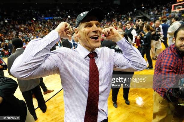 Head coach Porter Moser of the Loyola Ramblers celebrates after defeating the Kansas State Wildcats during the 2018 NCAA Men's Basketball Tournament...