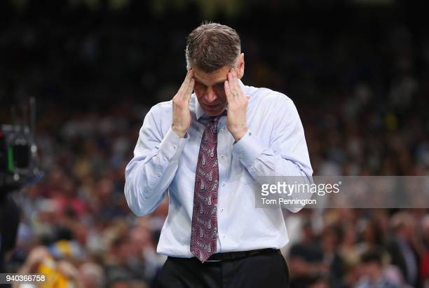 Head coach Porter Moser of the Loyola Ramblers reacts after being defeated by the Michigan Wolverines during the 2018 NCAA Men's Final Four Semifinal...