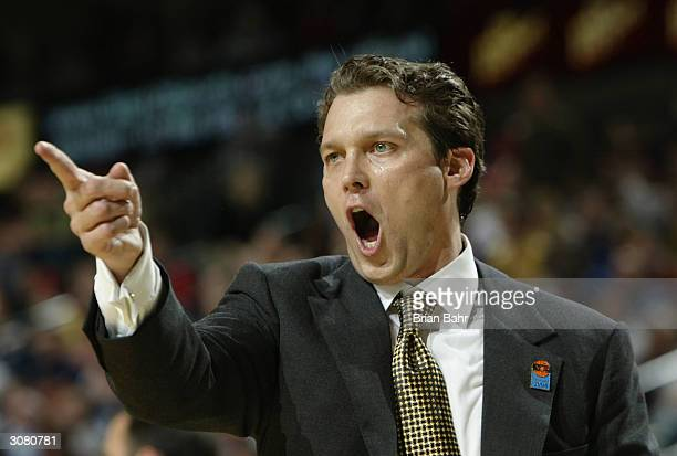 Head Coach Quin Snyder of the Missouri Tigers yells out instructions to one of his players in firsthalf action against the Kansas Jayhawks during the...
