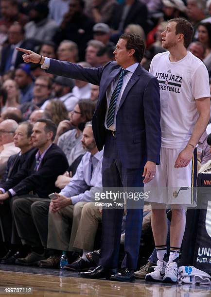 Head coach Quin Snyder, of the Utah Jazz directs his players along with forward Joe Ingles during a game against the Golden State Warriors during a...