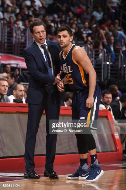 Head Coach Quin Snyder of the Utah Jazz speaks with Raul Neto during a game against the LA Clippers on March 25 2017 at STAPLES Center in Los Angeles...