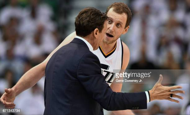 Head coach Quin Snyder of the Utah Jazz talks with his player Joe Ingles in the second half of their 111-106 loss to the Los Angeles Clippers in Game...