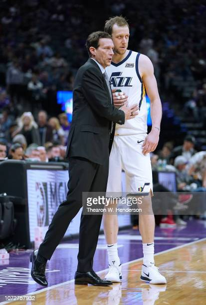 Head coach Quin Snyder of the Utah Jazz talks with his player Joe Ingles during an NBA basketball game against the Sacramento Kings at Golden 1...