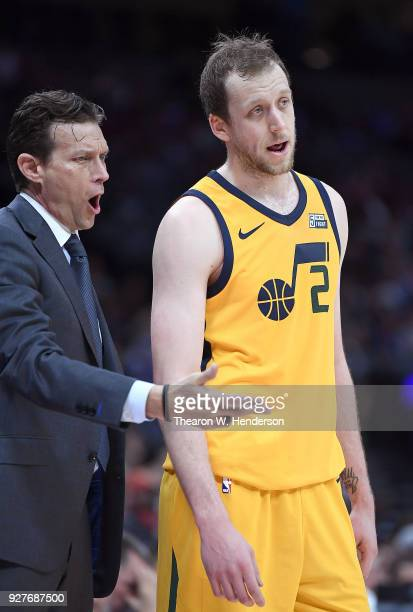 Head coach Quin Snyder of the Utah Jazz talks with his player Joe Ingles while there's a break in the action against the Sacramento Kings during an...