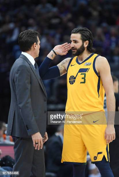 Head coach Quin Snyder of the Utah Jazz talks with his player Ricky Rubio while there's a break in the action against the Sacramento Kings during an...