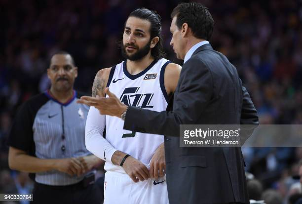 Head coach Quin Snyder of the Utah Jazz talks with his player Ricky Rubio against the Golden State Warriors during an NBA basketball game at ORACLE...