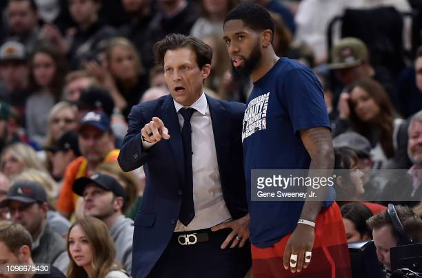 Head coach Quin Snyder of the Utah Jazz talks with his player Royce O'Neale in the first half of a NBA game against the San Antonio Spurs at Vivint...
