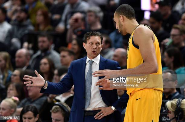 Head coach Quin Snyder of the Utah Jazz talks with his player Rudy Gobert during a game against the Phoenix Suns at Vivint Smart Home Arena on...