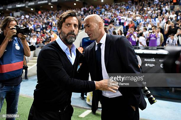 Head coach Quique Sanchez Flores of RCD Espanyol and Head coach Zinedine Zidane of Real Madrid CF shake hands prior to the La Liga match between RCD...