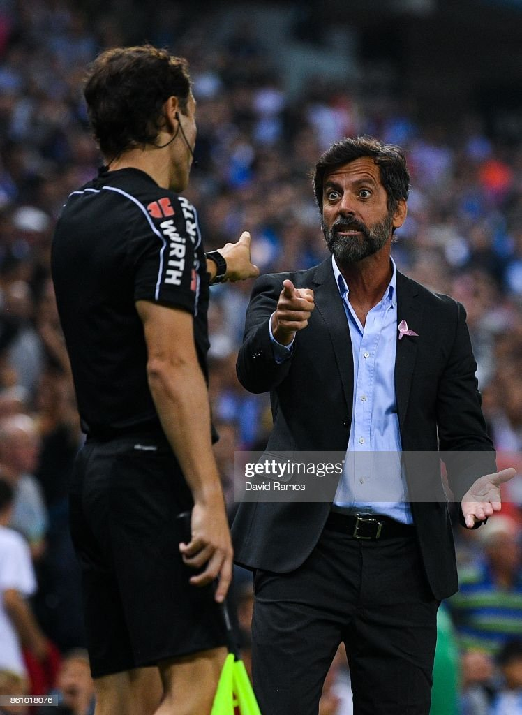 Head coach Quique Sanchez Flores of RCD Espanyol argues with the assistant referee after Gerard Moreno of RCD Espanyol (not in picture) scored a disallowed goal during the La Liga match between Espanyol and Levante at Cornella-El Prat stadium on October 13, 2017 in Barcelona, Spain.