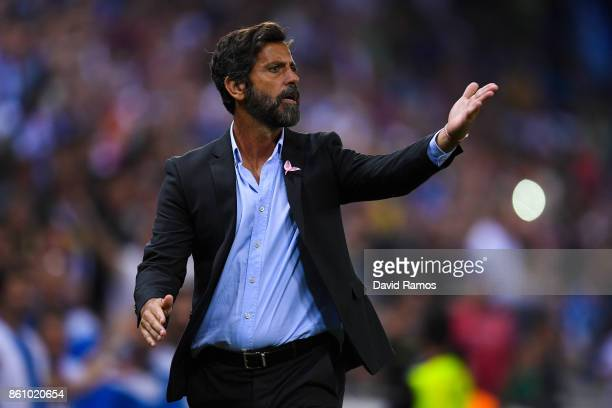 Head coach Quique Sanchez Flores of RCD Espanyol argues with the assistant referee after Gerard Moreno of RCD Espanyol scored a disallowed goal...