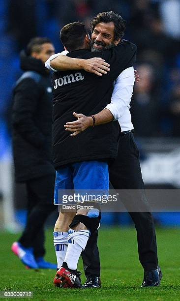 Head coach Quique Sanchez Flores of RCD Espanyol celebrates with his players at the end of the La Liga match between RCD Espanyol and Sevilla FC at...