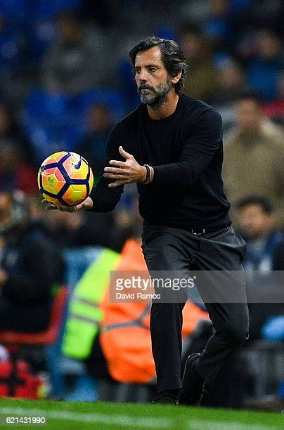Head coach Quique Sanchez Flores of RCD Espanyol throws the ball during the La Liga match between RCD Espanyol and Athletic Bilbao at CornellaEl Prat...