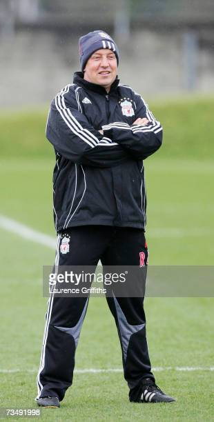 Head coach Rafael Benitez of Liverpool smiles to his players during a training session at Melwood Training Ground on March 5 2007 in Liverpool England