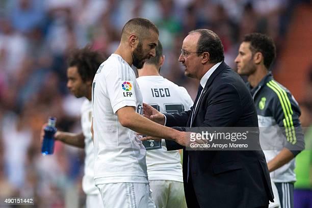 Head coach Rafael Benitez of Real Madrid CF gives instructions to his player Karim Benzema during the La Liga match between Real Madrid CF and Malaga...