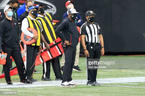Head coach Raheem Morris of the Atlanta Falcons waits on a replay decision during the Week 15 NFL game between the Atlanta Falcons and the Tampa Bay...