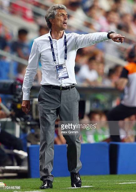 Head coach Rainer Adrion of Germany gestures during the UEFA European U21 Championship Group B match between Russia and Germany at Netanya Stadium on...