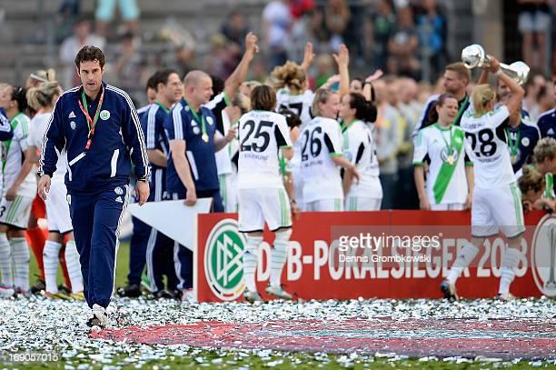 Head coach Ralf Kellermann of Wolfsburg walks on the pitch after the Women's DFB Cup Final between VfL Wolfsburg and 1 FFC Turbine Potsdam at Rhein...