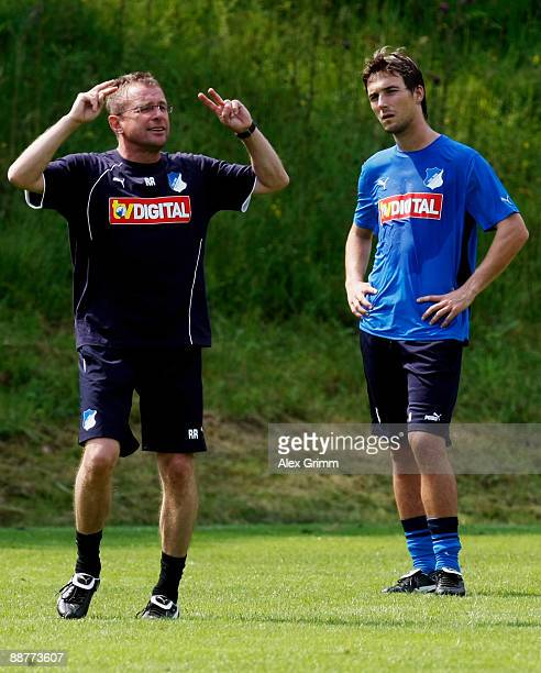Head coach Ralf Rangnick gestures as he stands next to Christian Eichner during a training session of 1899 Hoffenheim during a training camp on July...