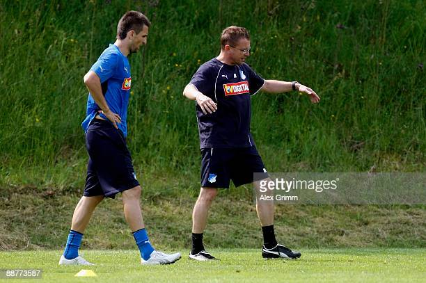 Head coach Ralf Rangnick gestures as he stands next to Vedad Ibisevic during a training session of 1899 Hoffenheim during a training camp on July 1,...