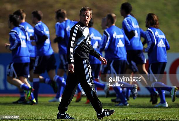 Head coach Ralf Rangnick looks on during a FC Schalke 04 training session at Parkstadium on March 23 2011 in Gelsenkirchen Germany