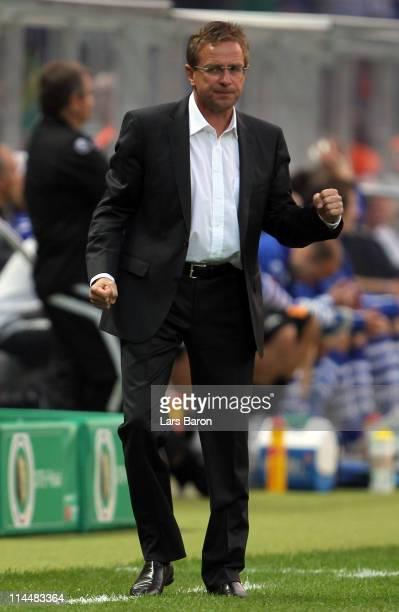 Head coach Ralf Rangnick of Schalke celebrates after Benedikt Hoewedes scored the third goal during the DFB Cup final match between MSV Duisburg and...