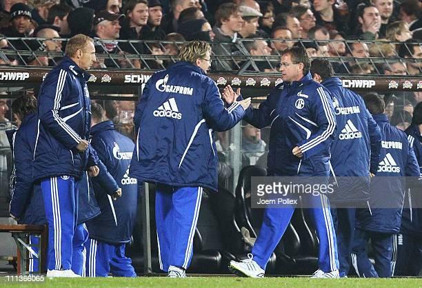 Head coach Ralf Rangnick of Schalke celebrates after Raul of Schalke scored his team's first goal during the Bundesliga match between FC St. Pauli...