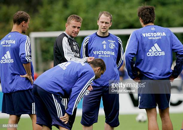 Head coach Ralf Rangnick speaks to the team and new player Fabian Ernst during the training session of Schalke 04 on July 23, 2005 in Gelsenkirchen,...