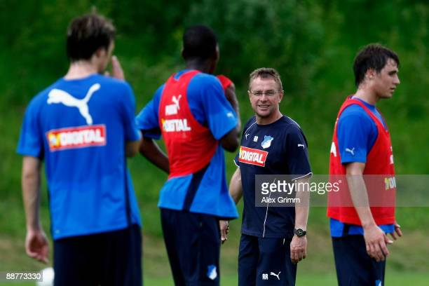 Head coach Ralf Rangnick walks between players during a training session of 1899 Hoffenheim during a training camp on July 1, 2009 in Stahlhofen am...