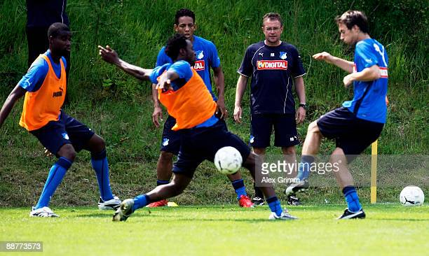 Head coach Ralf Rangnick watches players exercise during a training session of 1899 Hoffenheim during a training camp on July 1, 2009 in Stahlhofen...