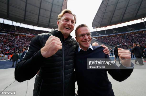 Head coach Ralph Hasenhuettl and Ralf Rangnick of RB Leipzig celebrate the participation of the UEFA Champions League in the next season after...