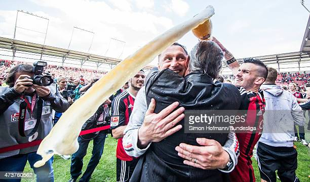 Head coach Ralph Hasenhuettl of Ingolstadt gets a beer shower after the Second Bundesliga match between FC Ingolstadt and RB Leipzig at Audi...