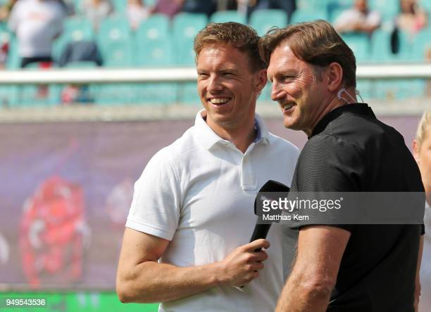 Head coach Ralph Hasenhuettl of Leipzig and head coach Julian Nagelsmann of Hoffenheim look on prior to the Bundesliga match between RB Leipzig and...