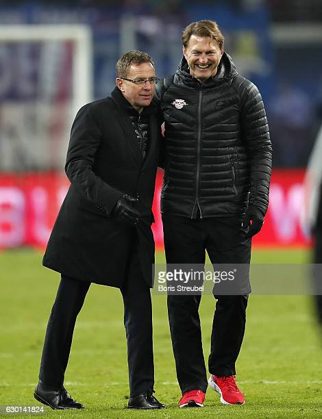 Head coach Ralph Hasenhuettl of RB Leipzig and his manager Ralf Rangnick hug after winning the Bundesliga match between RB Leipzig and Hertha BSC at...