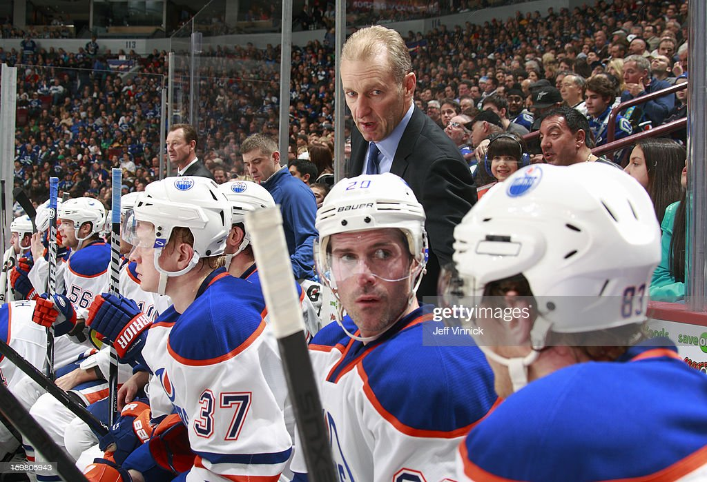 Head coach Ralph Krueger of the Edmonton Oilers talks to his bench during their NHL game against the Vancouver Canucks at Rogers Arena January 20, 2013 in Vancouver, British Columbia, Canada. Edmonton won 3-2 in a shootout.