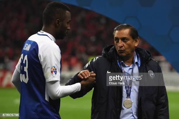 Head coach Ramon Diaz of AlHilal shakes hands with Osama Hawsawi at the award ceremony after the AFC Champions League Final second leg match between...