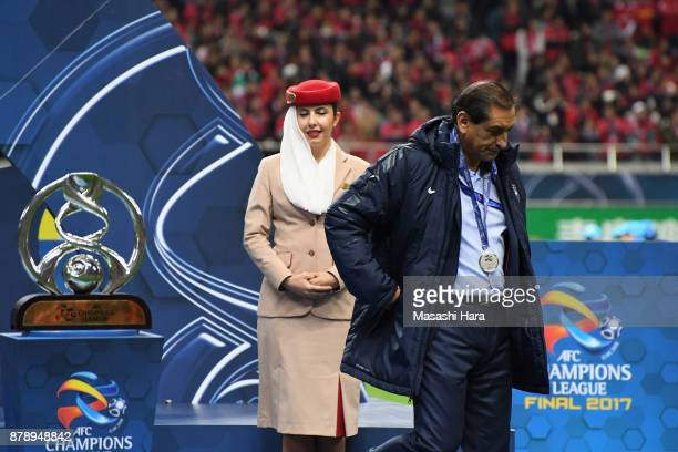 Head coach Ramon Diaz of AlHilal walks past the AFC Champions League Trophy at the medal ceremony after the AFC Champions League Final second leg...