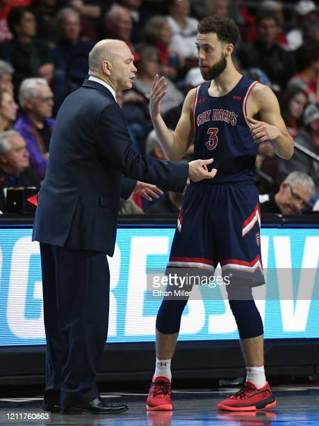 Head coach Randy Bennett of the Saint Mary's Gaels talks with Jordan Ford during their game against the Gonzaga Bulldogs in the championship game of...